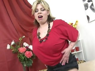Big Tited Blonde Mummy Flavia Gargles A Fake Penis From In Inbetween Her Boobies